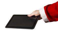La mano di Santa con un PC della compressa su un fondo bianco Fotografia Stock Libera da Diritti