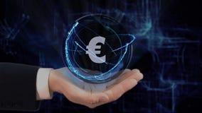 La mano dipinta mostra il segno EUR dell'ologramma di concetto sulla sua mano stock footage