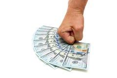 La mano ed i dollari dell'uomo su un fondo bianco Fotografia Stock Libera da Diritti