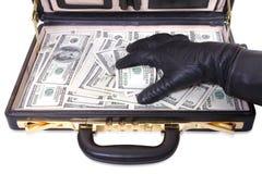 La mano en un guante toma el dinero fotografía de archivo
