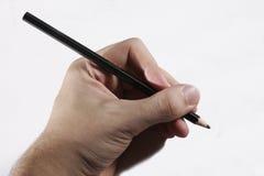 La mano escribe Imagen de archivo libre de regalías