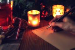 La mano escribe año del deseo Foto de archivo libre de regalías