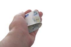 La mano está sosteniendo un nuevo billete de banco del euro 5 Imagen de archivo