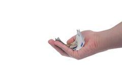 La mano está sosteniendo un nuevo billete de banco del euro 5 Imagenes de archivo