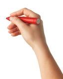 La mano femenina está lista para dibujar con el marcador rojo Aislado Imagen de archivo libre de regalías