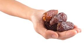 La mano femenina que lleva a cabo la fecha da fruto VIII Fotografía de archivo libre de regalías