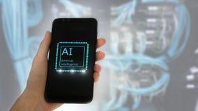 La mano femenina sostiene el teléfono, en la pantalla la inscripción: inteligencia artificial holograma 3D del icono en fondo del fotos de archivo