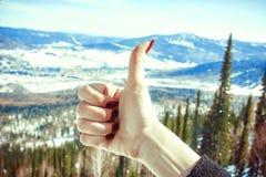 La mano femminile mostra la classe Immagine Stock