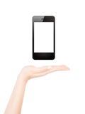 La mano femminile presenta lo Smart Phone in bianco Fotografia Stock