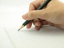 La mano femminile scrive il taccuino Immagini Stock Libere da Diritti