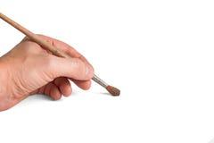 La mano giudica la spazzola a tiraggio isolata fotografia stock libera da diritti