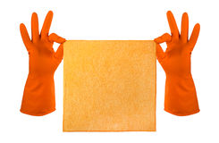 La mano in guanto di gomma arancio tiene uno straccio arancio - alloggi la pulizia Fotografia Stock