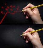 La mano humana que sostiene el lápiz y drena fotografía de archivo libre de regalías