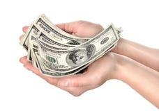 La mano lleva a cabo centenares de dólares Fotografía de archivo libre de regalías