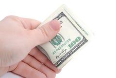 La mano lleva a cabo dólares en blanco Imagen de archivo libre de regalías