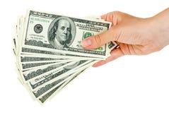 La mano lleva a cabo el manojo de $100 cuentas Imagen de archivo