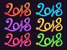La mano multicolora dibujada poniendo letras a la tarjeta de felicitación fijó el ejemplo del vector de la Feliz Año Nuevo 2018 Fotos de archivo