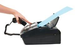 La mano presiona el botón del fax Foto de archivo libre de regalías