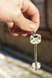 La mano que guarda claves Imagenes de archivo