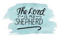 La mano que pone letras al señor es mi pastor con el palillo en fondo de la acuarela foto de archivo