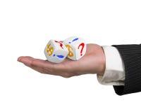 La mano que sostiene dos corta en cuadritos Imagen de archivo libre de regalías