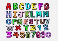La mano real dibujada pone letras a la fuente escrita con una pluma Imagen de archivo libre de regalías