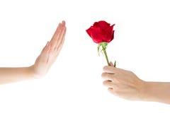 La mano rechazó el regalo, flores Fotografía de archivo