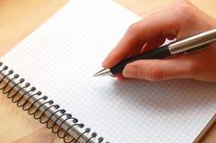 La mano scrive un messaggio Fotografia Stock