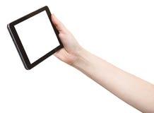 La mano sostiene el panel táctil con la pantalla del recorte Imagen de archivo libre de regalías