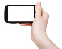 La mano sostiene el teléfono elegante aislado Fotos de archivo libres de regalías