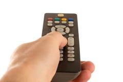 La mano sostiene la TV teledirigida Foto de archivo