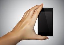 La mano sta tenendo Smartphone nella fucilazione Immagine Stock