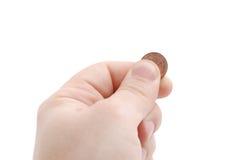 La mano tiene l'euro centesimo Fotografia Stock