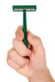 La mano tiene la macchina utensile per radersi Fotografie Stock Libere da Diritti