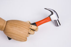La mano tiene un martello Fotografia Stock Libera da Diritti