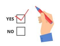 La mano umana scrive sì il voto su una scheda di votazione Immagini Stock