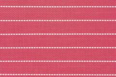 La mantelería roja y los puntos blancos alinean para el fondo Foto de archivo libre de regalías