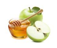 La manzana y la miel verdes sacuden por Año Nuevo judío Imagenes de archivo