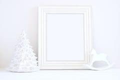 La maquette de Noël a dénommé la photographie courante avec le cadre blanc Photographie stock