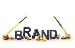 La marca arranca para arriba: Máquinas que construyen marca-palabra. Foto de archivo