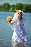 La mariée dans l'eau Photo libre de droits