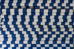 La materia textil rayó las cubiertas para los sunbeds, apiladas encima de uno a, fondo fotos de archivo libres de regalías