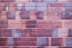 la mattone-forma decorativa ha piastrellato la struttura della parete fondo, esteriore immagine stock libera da diritti