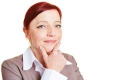 El mejor pensamiento de la mujer de negocios del ager Imágenes de archivo libres de regalías