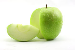 La mela verde affettata fotografie stock