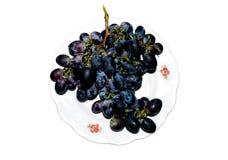 La mentira de las uvas en una placa fotografía de archivo