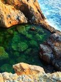 La mer a arrosé la piscine Image libre de droits