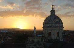 La Merced Church, Granada, Nicaragua. The tower of La Merced Church in Granada, Nicaragua is silhouetted against the setting sun stock photo
