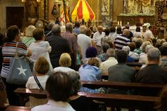 La Merced Church Service in Barcelona. Photo of church service at la merced church in barcelona spain on 9/23/18. These people are taking communion stock photography