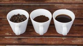 La messa a punto d'annata ha sparato di caffè nero con latte Immagini Stock